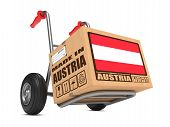 pic of free-trade  - Cardboard Box with Flag of Austria and Made in Austria Slogan on Hand Truck White Background - JPG