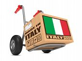 image of free-trade  - Cardboard Box with Flag of Italy and Made in Italy Slogan on Hand Truck White Background - JPG
