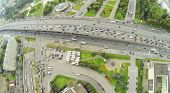 Day traffic on street and overpass bridge. View from unmanned quadrocopter.