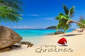 stock photo of christmas hat  - Merry Christmas with santa hat on the tropical beach - JPG