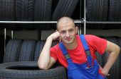 picture of auto repair shop  - A mechanic is taking a small break in a tire workshop - JPG