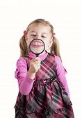 picture of tooth gap  - Funny girl showing teeth through a magnifying glass - JPG