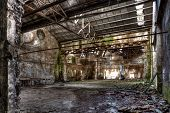 foto of collapse  - interior of am abandoned factory with rubble and debris  - JPG
