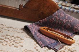 stock photo of handloom  - hands of craftwomen working on weaving - JPG