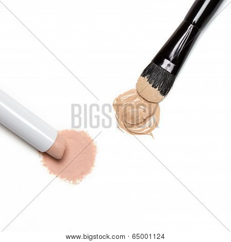 Concealer Pencil And Foundation With Makeup Brush
