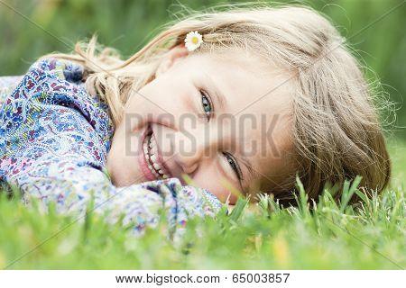 Girl Lying On Grass Laughing