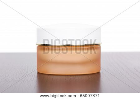 Box With Cream On Table