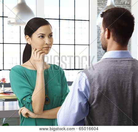 Casual people talking at office, asian female officeworker paying attention.