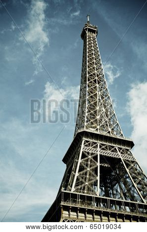 View of the Eiffel Tower with blue sky and white clouds, Paris, France