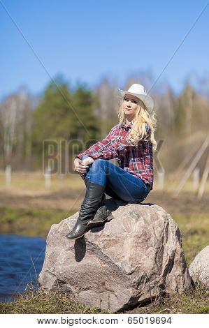 Portrait Of Caucasian Cowgirl Wearing Stetson Outdoors