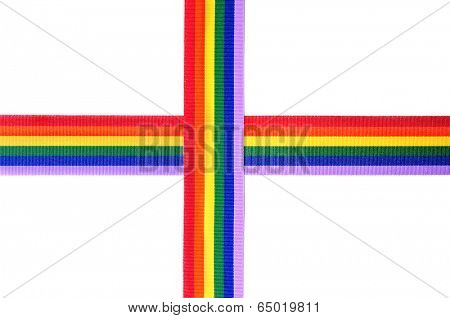 crossed rainbow ribbons on a white background