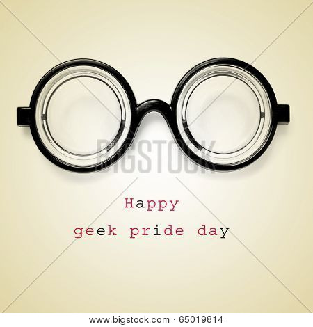 a pair of nearsighted glasses and the sentence happy geek pride day on a beige background