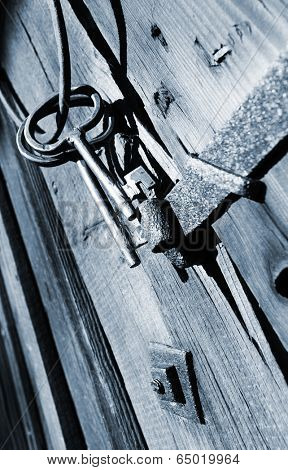 old antique 17th century keys hanging on old wooden wall