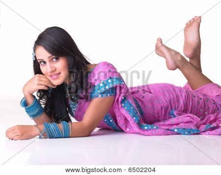 Indian girl lying on the floor