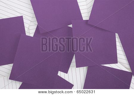Purple paper strewn over notepad paper