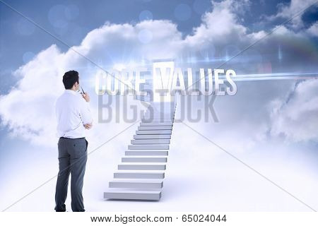 The word core values and businessman holding glasses against open door at top of stairs in the sky