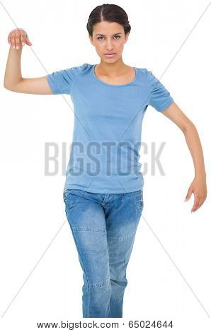 Powerless brunette in jeans and tshirt on white background