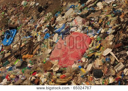 KOTA KINABALU, MALAYSIA - APRIL 26 2014: Pollution in shanty town. Photo showing environmental problem of garbage build up in poor shanty town due to lack or refuse collection or recycling.
