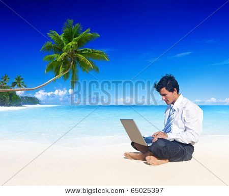 Businessman working on a beach.