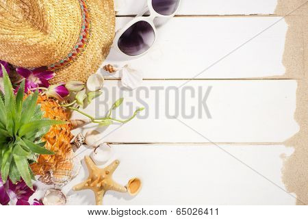 Summer holiday setting with straw hat, pineapple and sunglasses