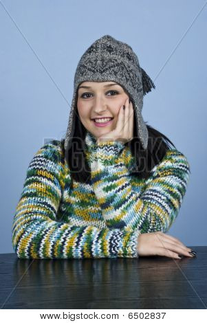 Teen Female Sit At Table And Smile