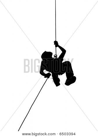 Silhouette Of Person Abseiling