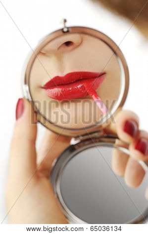 beautiful woman make up with a hand mirror
