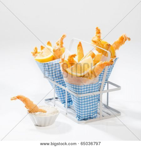 Tempura prawns with fries wrapped in cones with a dish of tartar sauce
