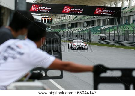 SEPANG, MALAYSIA - MAY 10, 2014: The BMW car of Jun San Chen and Ollie Millroy races down the straight at the free practice session of the Malaysian Super Series Round 2 in Sepang Circuit.