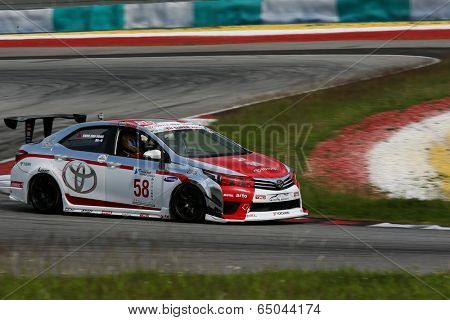 SEPANG, MALAYSIA - MAY 10, 2014: The Toyota Altis car of Chen Jian Hong takes to the track at the Thailand Super 2000 race of the Thailand Super Series Rd 1 in Sepang International Circuit.