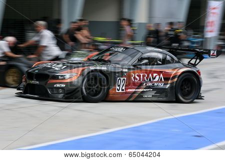 SEPANG, MALAYSIA - MAY 10, 2014: The BMW car of Morris Chen and Tatsuya Tanigawa returns to the pit lane after the free practice session of the Malaysian Super Series Round 2 in Sepang Circuit.