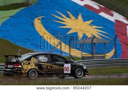SEPANG, MALAYSIA - MAY 10, 2014: The Honda Civic car of Pitsanu Sirimonkolkasem takes to the track at the Thailand Super 2000 race of the Thailand Super Series Rd 1 in Sepang International Circuit.