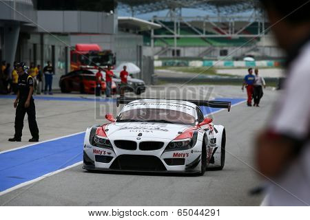 SEPANG, MALAYSIA - MAY 10, 2014: The BMW car of drivers Jun San Chen and Ollie Millroy returns to the pit lane after the free practice session of the Malaysian Super Series Round 2 in Sepang Circuit.