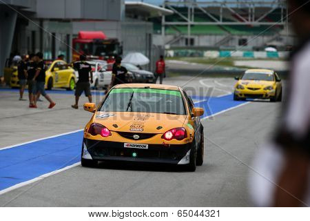 SEPANG, MALAYSIA - MAY 10, 2014: The race cars return to the pit lane after the free practice session of the Malaysian Super Series Round 2 in Sepang International Circuit.