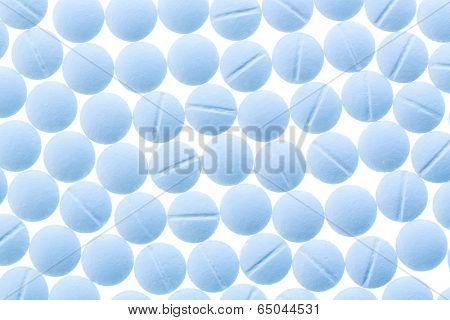 light blue tablets, symbol photo for medicine, remedies and painkillers