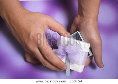 Man's Hand Holding Present