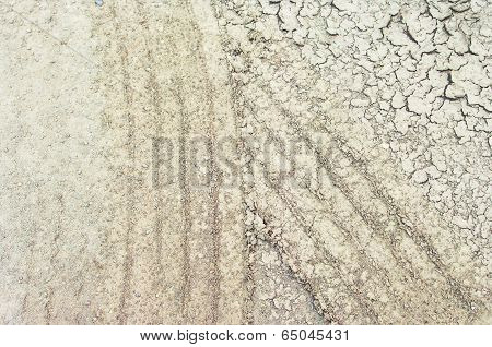 Tire Mark In Cracked Soil.