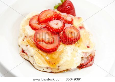 Sliced Strawberries On Top Of Fresh Hotcakes