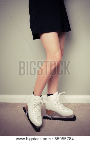 Woman In Ice Skates At Home