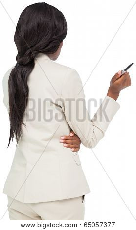 Thinking businesswoman in cream suit on white background