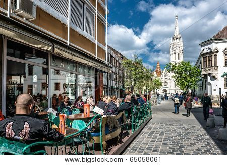 Tourists Sitting In A Sidewalk Cafe Near Matthias Church