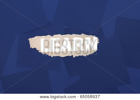 The word learn against digitally generated blue paper strewn