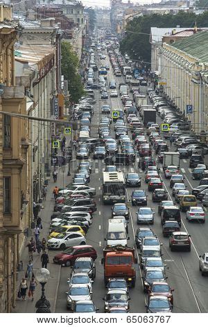 ST.PETERSBURG, RUSSIA - JUN 27, 2013: Cars stands in traffic jam on the city center. Shortness of traffic due to repairs Greater Obukhov (cable-stayed) Bridge.