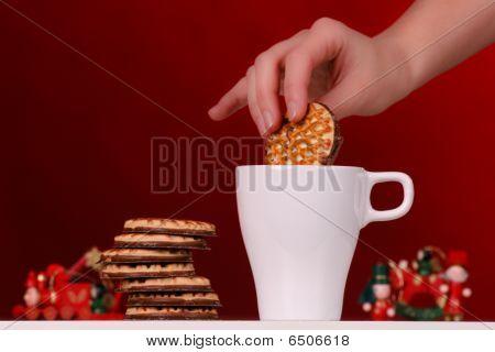 cookie being dipped in milk