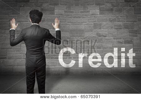 businessman standing hands up credit