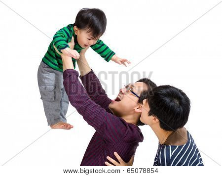 Happy asian family with dad throwing up