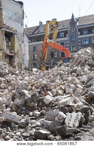 Demolition of an old building with heavy machinery for new construction