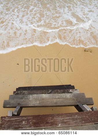 Sand beach, wave and wooden staircase