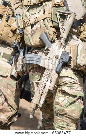 Soldiers In Us Army Special Forces Uniform, Close Up On Rifle