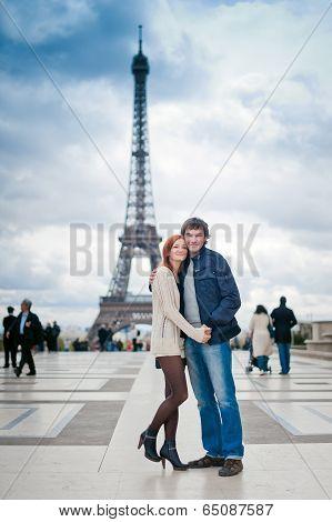 Loving Couple Near The Eiffel Tower In Paris